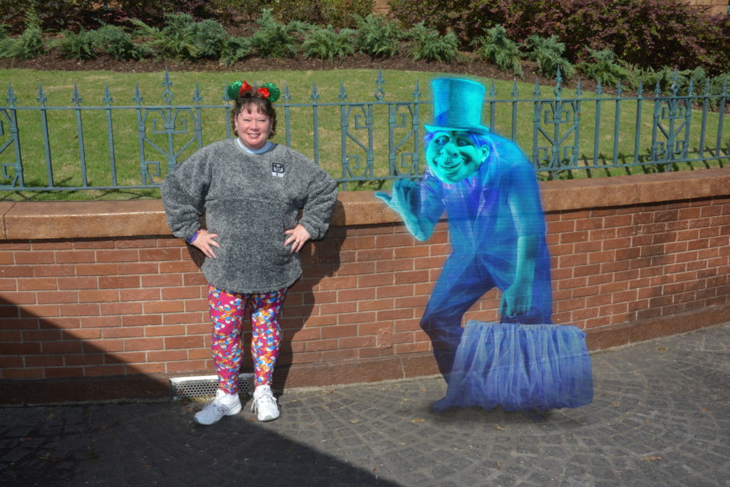 Personal PhotoPass picture with magic in front of Haunted Mansion