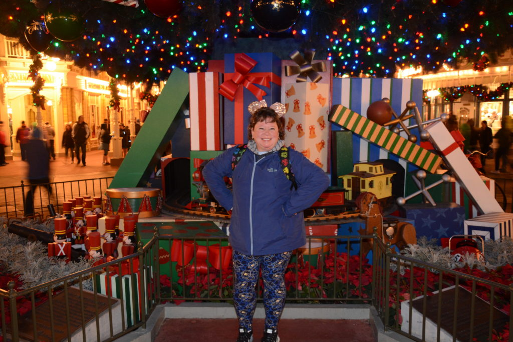 PhotoPass Pic in front of Magic Kingdom tree.
