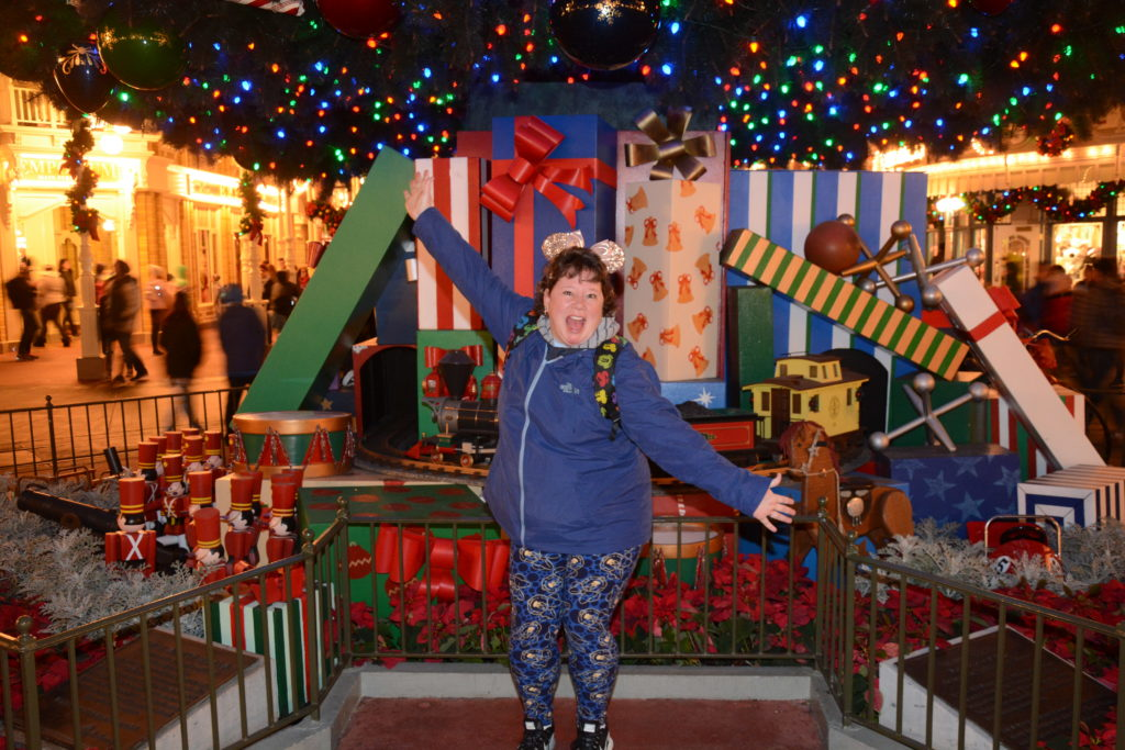 PhotoPass picture in front of Magic Kingdom Christmas tree.