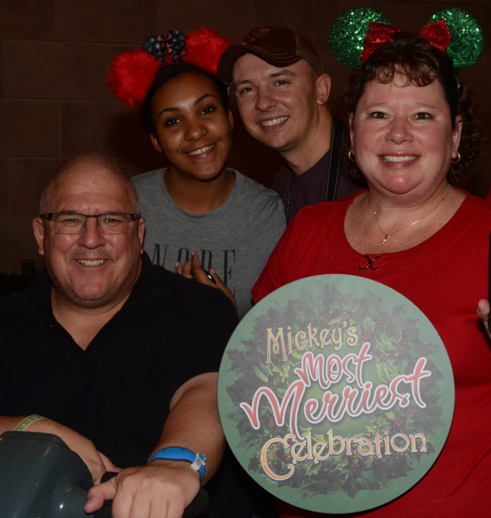 PhotoPass family at Christmas party