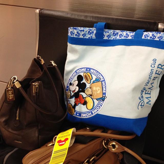 Disney Vacation Club canvas bag at the airport